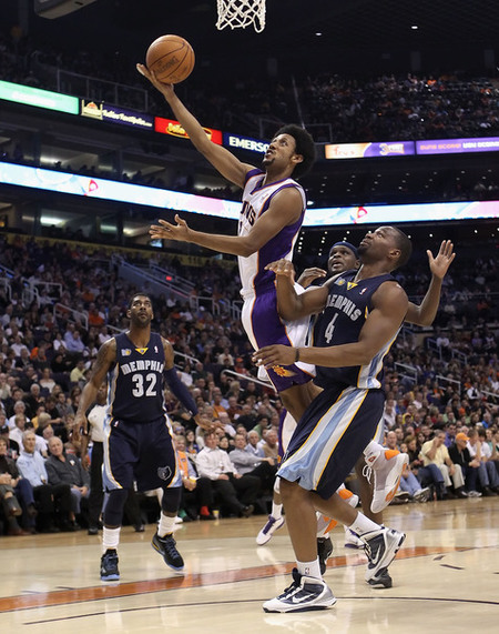 PHOENIX - DECEMBER 08:  Josh Childress #1 of the Phoenix Suns lays up a shot over Sam Young #4 of the Memphis Grizzlies during the NBA game at US Airways Center on December 8 2010 in Phoenix Arizona.  (Photo by Christian Petersen/Getty Images)