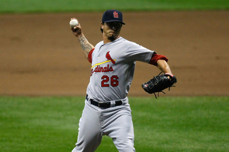 MILWAUKEE, WI - JUNE 10: Kyle Lohse's ridiculous tattoo pitches against the Milwaukee Brewers at Miller Park on June 10, 2011 in Milwaukee, Wisconsin. (Photo by Scott Boehm/Getty Images)