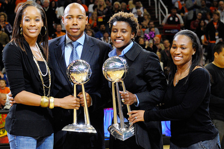 Phoenix Mercury players Tangela Smith (left) and Temeka Johnson along with coaches Cory Gaines and Bridget Pettis were honored with a standing ovation during the Phoenix Suns home opener. (Photo by Max Simbron)