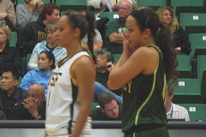 While USF guard Rheina Ale (right) had a career-high 27 points last night against Cal Poly, it was younger sister Kristen (right) whose team got the win.