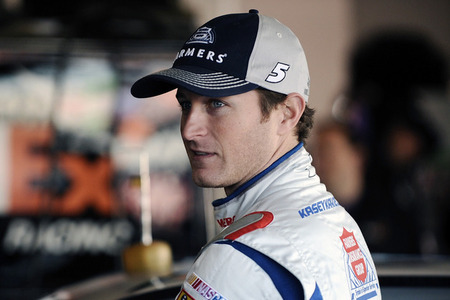 DAYTONA BEACH, FL - JANUARY 14:  Kasey Kahne, driver of the #5 Farmer's Insurance Group, stands in the garage area during Daytona Preseason Thunder at Daytona International Speedway on January 14, 2012 in Daytona Beach, Florida.  (Photo by Jared C. Tilton/Getty Images for NASCAR)