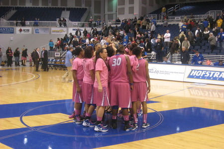 Hofstra Pride players meet at center court of the Mack Sports Complex after a loss in which they wore pink for Crush Clare's Cancer night on Thursday. Photo by Ray Floriani.