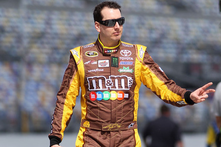 DAYTONA BEACH, FL - FEBRUARY 19:  Kyle Busch, driver of the #18 M&M's Brown Toyota, walks on the grid during qualifying for the NASCAR Sprint Cup Series Daytona 500 at Daytona International Speedway on February 19, 2012 in Daytona Beach, Florida.  (Photo by Jamie Squire/Getty Images)