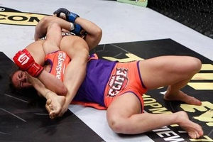 ronda rousey armbars miesha tate at strikeforce on march 3 2012 in ...