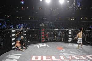 Joe Warren (left) was brutally beaten around by Pat Curran (right), losing his Bellator 145-pound title in the process. (Photo: Bellator)