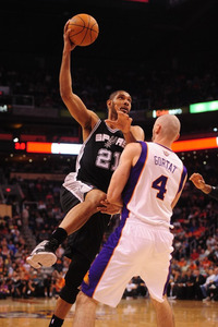 Mar. 27, 2012; Phoenix, AZ, USA; San Antonio Spurs forward (21) Tim Duncan takes a shot against Phoenix Suns center (4) Marcin Gortat in the first quarter at the US Airways Center. Mandatory Credit: Mark J. Rebilas-US PRESSWIRE