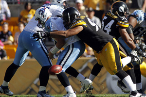 PITTSBURGH, PA - OCTOBER 9:   Cameron Heyward #97 of the Pittsburgh Steelers causes a fumble against  Matt Hasselbeck #8 of the Tennessee Titans during the game on October 9, 2011 at Heinz Field in Pittsburgh, Pennsylvania.  The Steelers defeated the Titans 38-17.  (Photo by Justin K. Aller/Getty Images)