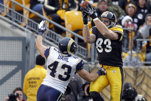 PITTSBURGH, PA - DECEMBER 24:  Heath Miller #83 of the Pittsburgh Steelers makes a catch against  Craig Dahl #43 of the St. Louis Rams during the game on December 24, 2011 at Heinz Field in Pittsburgh, Pennsylvania.  The Steelers won 27-0.  (Photo by Justin K. Aller/Getty Images)