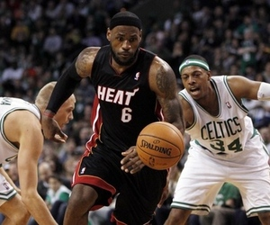 April 1, 2012; Boston, MA, USA; Miami Heat forward LeBron James (6) drives between Boston Celtics center Greg Stiemsma (54) and small forward Paul Pierce (34) during the third quarter at TD Banknorth Garden. Boston won 91-72. Mandatory Credit: Greg M. Cooper-US PRESSWIRE
