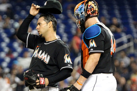 MIAMI, FL - JUNE 22:  Pitcher Anibal Sanchez #19 and Catcher John Buck #14 of the Miami Marlins chat against the Toronto Blue Jays during a interleague game at Marlins Park on June 22, 2012 in Miami, Florida.  (Photo by Marc Serota/Getty Images)