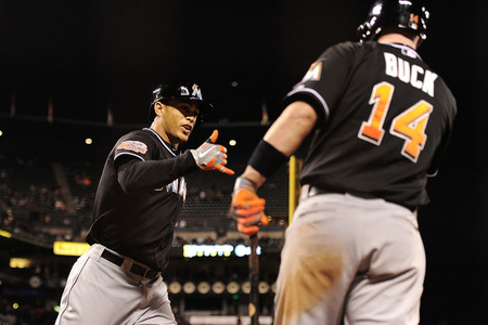 SAN FRANCISCO, CA - MAY 02:  Giancarlo Stanton #27 of the Miami Marlins is congratulated by John Buck after Stanton hit a solo home run against the San Francisco Giants in the tenth inning at AT&amp;T Park on May 2, 2012 in San Francisco, California. The Marlins won the game 3-2 in ten innings.  (Photo by Thearon W. Henderson/Getty Images)