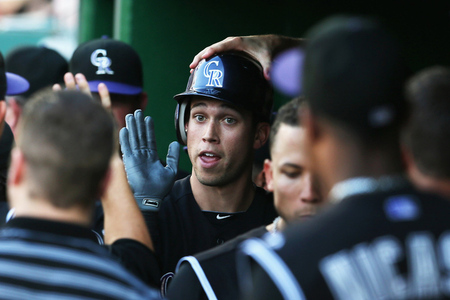 WASHINGTON, DC - JULY 06:  Tyler Colvin #21 of the Colorado Rockies celebrates in the dugout after hitting a solo home run during the second inning against the Washington Nationals at Nationals Park on July 6, 2012 in Washington, DC.  (Photo by Rob Carr/Getty Images)