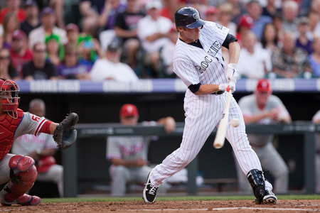 DENVER, CO - JULY 13:  Josh Rutledge #14 of the Colorado Rockies hits an RBI single in the second inning against the Philadelphia Phillies at Coors Field on July 13, 2012 in Denver, Colorado.  (Photo by Justin Edmonds/Getty Images)