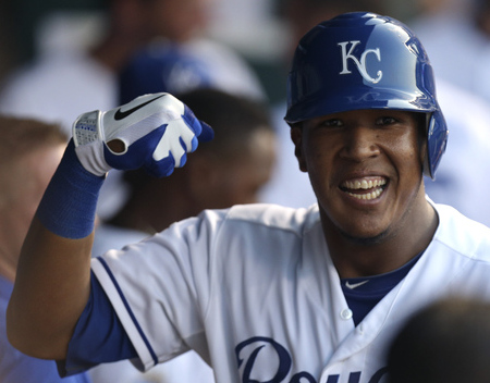 KANSAS CITY, MO - JULY 16: Salvador Perez #13 of the Kansas City Royals celebrates his home run against the Seattle Mariners in the third inning at Kauffman Stadium on July 16, 2012 in Kansas City, Missouri. (Photo by Ed Zurga/Getty Images)