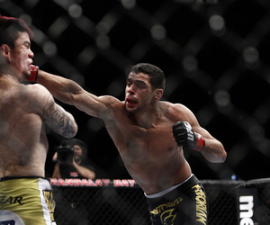 Renan Barao, right, will answer questions from the media at the UFC 149 press conference Thursday.