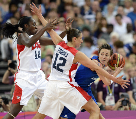 Aug 11, 2012; London, United Kingdom; France guard Celine Dumerc (right) is trapped between USA center Tina Charles (14) and guard Diana Taurasi (12) during the women's basketball gold medal game in the London 2012 Olympic Games at North Greenwich Arena. Photo by Bob Donnan-USA TODAY Sports.