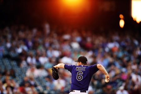 August 16, 2012; Denver, CO, USA; Colorado Rockies pitcher Alex White (6) delivers a pitch during the third inning against the Miami Marlins at Coors Field.  Mandatory Credit: Chris Humphreys-US PRESSWIRE