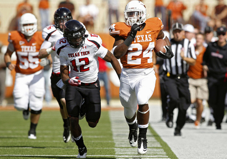 AUSTIN, TX - NOVEMBER 5: Running back Joe Bergeron #24 of the Texas Longhorns makes a second quarter long run down the sidelines against safety D. J. Johnson #12 of the Texas Tech Red Raiders on November 5, 2011 at Darrell K. Royal-Texas Memorial Stadium in Austin, Texas. (Photo by Erich Schlegel/Getty Images)