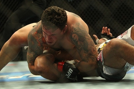 Dec 10, 2011; Toronto, ON, Canada; UFC fighter Frank Mir (top) against fighter Minotauro Nogueira during a heavyweight bout at UFC 140 at the Air Canada Centre. Mandatory Credit: Tom Szczerbowski-US PRESSWIRE