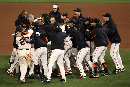 The Giants celebrate after a sacrifice fly by Juan Uribe scored  Aubrey Huff to win 6-5 over the Phillies in Game Four of the NLCS during  the 2010 MLB Playoffs at AT&T Park on October 20 2010 in San  Francisco. (Photo by Ezra Shaw/Getty Images)