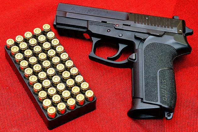 Handgun-pistol-sig-pro-wikimedia_large