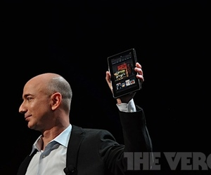 Jeff Bezos holding the Kindle Fire