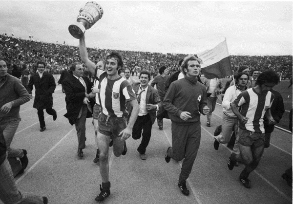 His day in the sun: The hero Edgar Schneider carries the Pokal flanked by Uli Hoeness and Gerd Müller