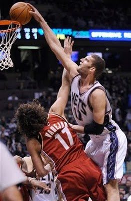 Brook_lopez_dunks_on_anderson_varejao_1_medium