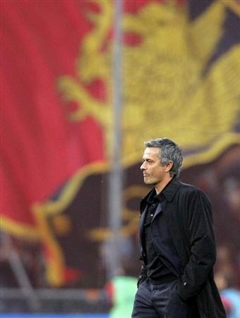 Mourinho framed against the Genoa fans
