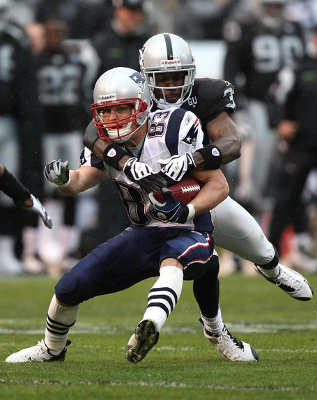 Wes-welker-catches-a-pass-as-the-raiders-johnson-makes-an-attempt-at-a-tackle_medium