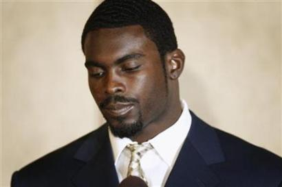 4064676957-file-photo-of-atlanta-falcons-quarterback-michael-vick-pausing-during_medium