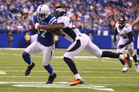 Hi-res-185451546-reggie-wayne-of-the-indianapolis-colts-is-tackled-by_crop_650_medium