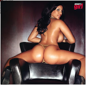 Cyn-santana-straddling-a-black-leather-chair-showing-off-her-booty-in-a-gold-thong-in-her-shoot-for-smooth-girl-magazine_medium
