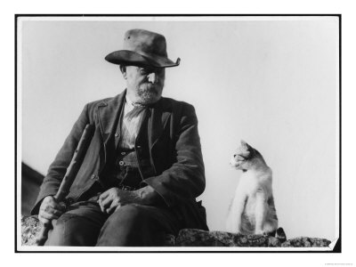 An-old-man-and-his-cat-sit-on-a-wall-in-the-cotswolds_medium