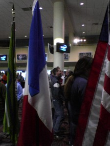 <em>Crowd through flags</em>