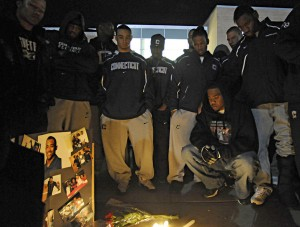 Football players gather at a memorial for Jasper Howard. Photo: Hartford Courant