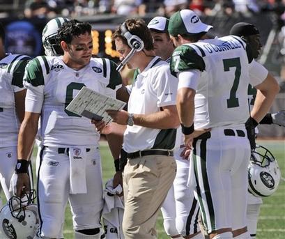 Jets-quarterback-mark-sanchez-and-teammate-kevin-oconnell-speak-with-offensive-coordinator-brian-schottenheirmer-on-the-sidelines_medium