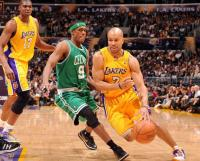 Derek_fisher_drives_against_rajon_rondo_medium