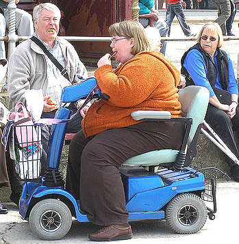 Fat_woman_on_scooter_31238072543_medium