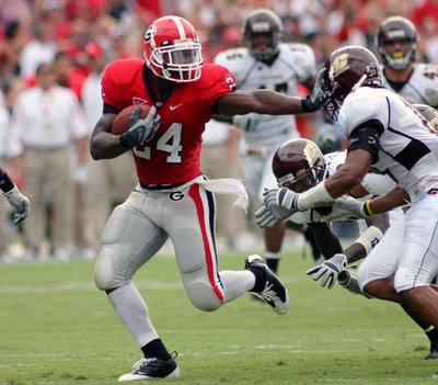 Knowshon_moreno_for_heisman_with_the_stiff_arm_vs_cmu_2008_medium
