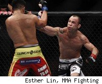 Wanderlei SIlva punches Cung Le at UFC 139.