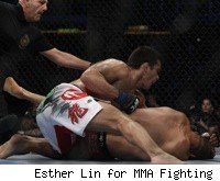 Machida beats Randy Couture at UFC 129.