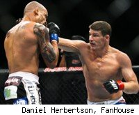 Michael Bisping punches Jorge Rivera at UFC 127.