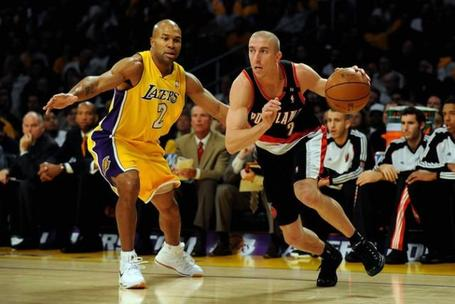Steve_blake_drives_the_baseline_against_derek_fisher_medium