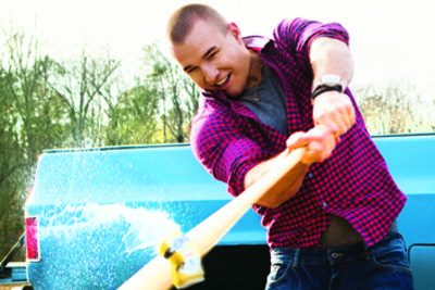 This is Mike Trout swinging a bat at a beer can in April issue of GQ