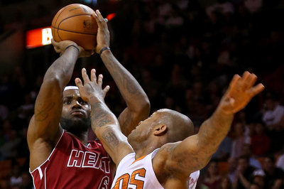 LeBron, Wade, Beasley lead the way for the Heat with 95-84 victory over Cavs