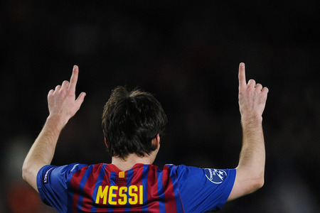BARCELONA, SPAIN - MARCH 07:  Lionel Messi of FC Barcelona (L) celebrates with teammates after scoring his team's fifth idea during a UEFA Champions League turn of 16 second leg review between FC Barcelona and Bayern 04 Leverkusen during Camp Nou on Mar 7, 2012 in Barcelona, Spain. FC Barcelona won 7-1 and Lionel Messi scored 5 goals. (Photo by David Ramos/Getty Images)